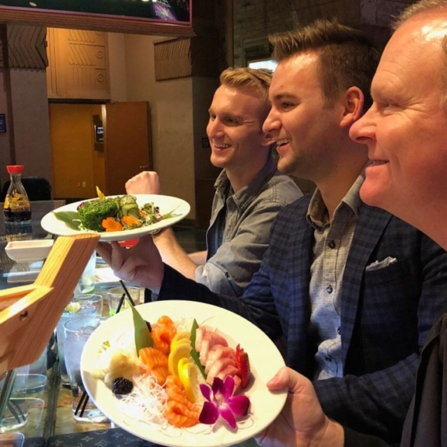 Duncan boys at a sushi bar
