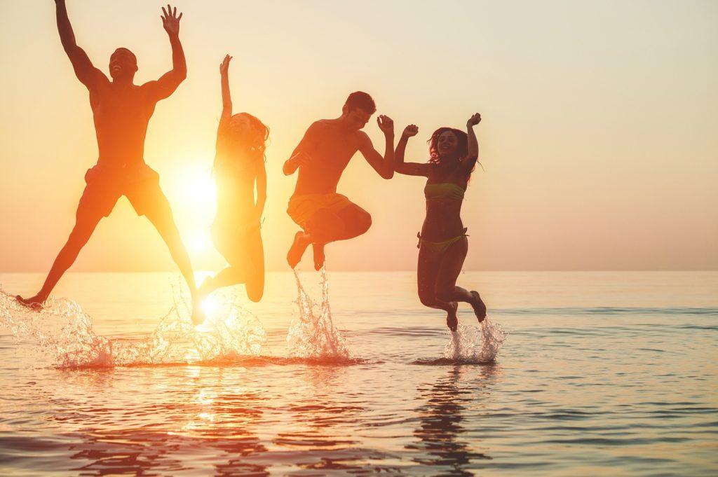 family-jumping-ocean-create-adventure-joy-everyday