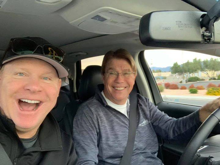 Brad Duncan with Bill Hawkins while driving
